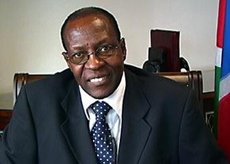 Dr Kaire Mbuende